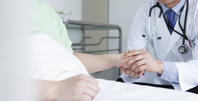 ED Physician Holding Patient Hand
