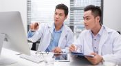 Physicians Reviewing Data Analytics Dashboard
