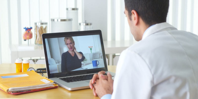 Doctor Speaks to Patient Via Computer During Telemedicine Visit